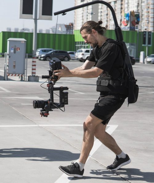 Image of our staff at Elite Video of Charlotte shoowing some footage out in a parking lot.